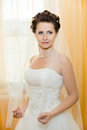 Fiancee vertical wedding portrait beautifull in white dress soft light Stock Photo