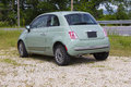 Fiat mint green two door sedan parked beside of the road in eureka springs arkansas rear and side view Stock Photo