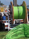fiber optic cable piled up behind an installation truck Royalty Free Stock Photo