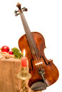 Fiddle to Christmas with candle Royalty Free Stock Photo