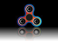 Fidget spinner icon - toy for stress relief and improvement of attention span. Filled multicolor and black color.