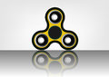 Fidget spinner icon - toy for stress relief and improvement of attention span. Filled with yellow and black color.