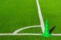 Field corner detail of mark in a sports grass with green plastic cone Royalty Free Stock Image