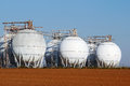 Field of crude oil tanks on agriculture field brown Royalty Free Stock Photo