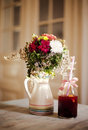 Field flowers and berries juice bunch of on wooden table Royalty Free Stock Images