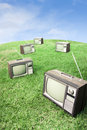 Field of grass with retro tv's Royalty Free Stock Image