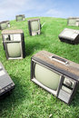 Field of grass with retro tv's Royalty Free Stock Photo