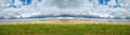 Field meadow sky clouds panorama panoramic banner nature landscape of a and in the image is a or Stock Images