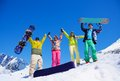 Fiends with snowboard in mountains happy friends men and women stand snow snowboards lifting and waving hands Stock Photos