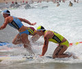 Fierce competition in white surf Stock Photos