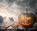 Fierce pumpkin on the table and dramatic sky Stock Images