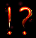 Fiery question mark and exclamation from the fire on a dark background Royalty Free Stock Photo