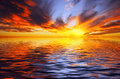 Fiery sunset over the sea in tropics Royalty Free Stock Photography
