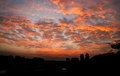 Fiery sunset scattered clouds Royalty Free Stock Photo