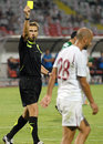 Fifa referee alexandru tudor shows a yellow card during the romanian league relegation play off between rapid bucharest and Stock Images