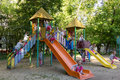 Fifteen clones of cute girl at children playground little Royalty Free Stock Photos