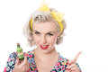 Fifties housewife with poison bottle, humorous concept, isolated Royalty Free Stock Photo