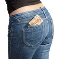Fifty euro banknotes in jeans back pocket isolated on white Stock Images