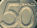 Fifty francs coin macro selective focus toned image Royalty Free Stock Photography
