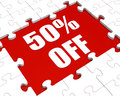 Fifty percent off puzzle means reduced discount or sale meaning Stock Images