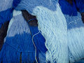 Fifty shades of blue piled skeins wool in many Royalty Free Stock Images