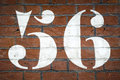 Fifty six large hand painted number on brick wall Stock Image