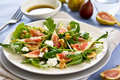 Fig,Goat cheese and rocket salad Stock Images
