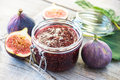 Fig marmalade on wooden background Stock Photo