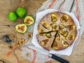 Fig pie with walnuts on a wooden desk Stock Photo