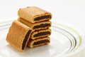 Fig rolls a stack of five on a plate with a white background Stock Image