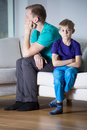 Fight between son and dad tired his sad Stock Image