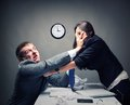Fight two young caucasian office worker starting to Stock Image