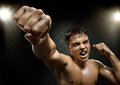 Fighter horizontal photo muscular young guy street cuff fist close up on camera and yell hard light Stock Images