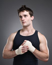Fighter taping hands portrait a young tough preparing for a fight Stock Images
