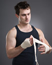 Fighter taping hands portrait a young tough preparing for a fight Stock Photography