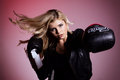 Fighting blond girl in black leather jacket Royalty Free Stock Photo