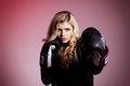 Fighting blond girl in black leather jacket Royalty Free Stock Image