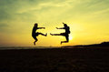 Fighting an enemy near the beach when sun goes down Royalty Free Stock Photo