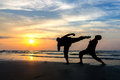 Fighting an enemy near the beach when sun rising up Stock Images