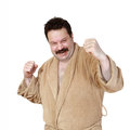 Fighting rage middle age man in robe shows stance with facial expression isolated on white background Royalty Free Stock Photos
