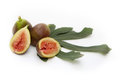 Figs with fig s leaves isolated on white Royalty Free Stock Photo