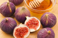 Figs with honey group of a bowl of in the background Stock Image