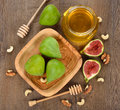 Figs with honey and nuts on a brown background Royalty Free Stock Images