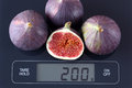 Figs on kitchen scale Royalty Free Stock Photo