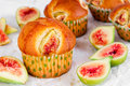 Figs muffins with fresh fruits on baking paper and wooden background Royalty Free Stock Photo