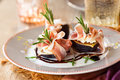 Figs with Prosciutto, Goat Cheese and Rosemary Stock Photo