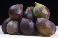 Figs set of ripe on a black background Royalty Free Stock Images