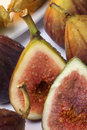 Figs are a soft pear shaped fruit with sweet dark flesh and many small seeds eaten fresh or dried Royalty Free Stock Photo