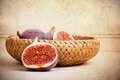 Figs still life in wicker basket antique peeling paint effect Royalty Free Stock Photo