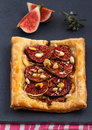 Figs tart gourmet puff pastry with almonds blue cheese and honey Royalty Free Stock Photography